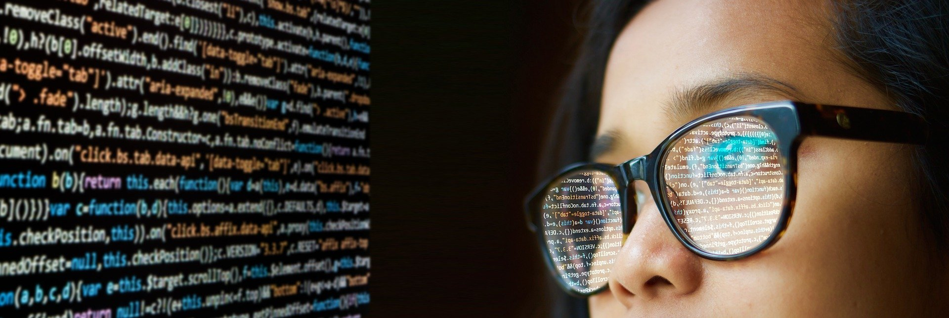 Woman coding with lines of code reflected in her glasses